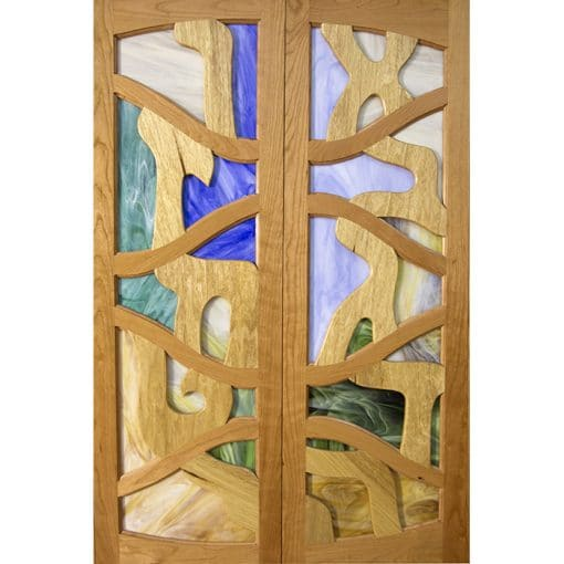 stained glass doors fro aron kodesh with woodwork and aleph bet