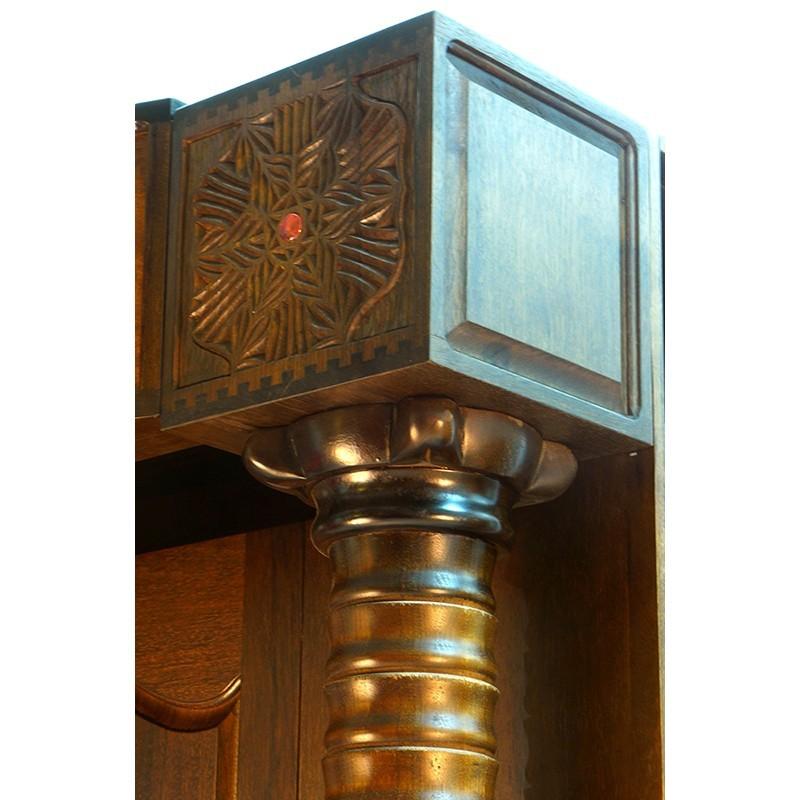 top detail of aron kodesh with bookshelves