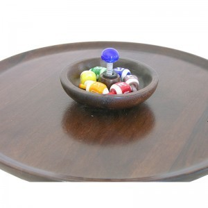 colorful glass dreidles and dreidle spinning board