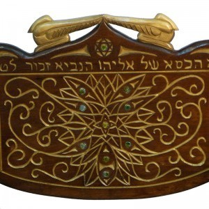 carving and gold detail with gold cherubim on kise eliyahu for synagogue