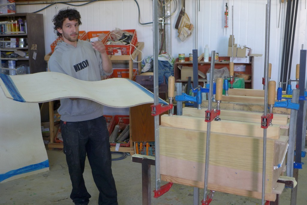 Tal holding a Curve Mold memorial board