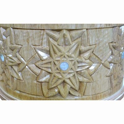 carving in solid wood with glass inlays