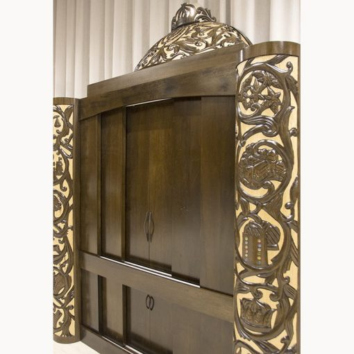 Two tone carving in deep relief with sliding doors for park plaza synagogue in solid wood