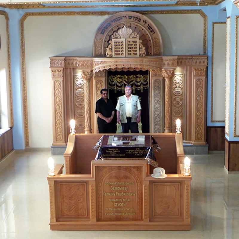 synagogue interior with aron kodesh and bimah deep carved in relief and twelve tribes