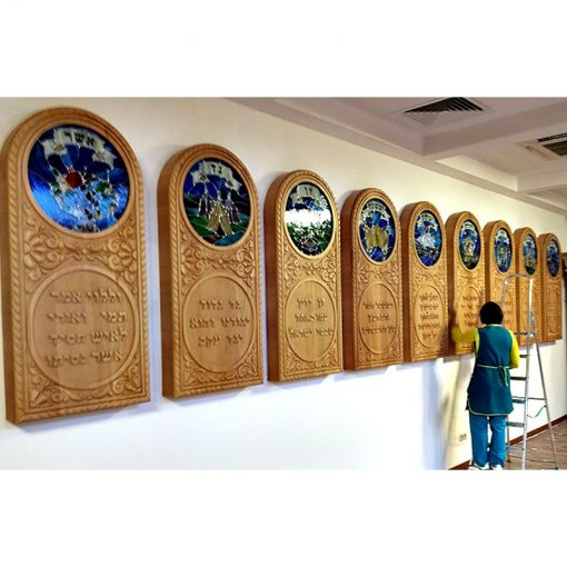Synagogue decorative art wallhanging depicting the twelve tribes in carving and stained glass