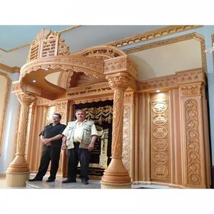 Carved domed top aron kodesh in synagogue with twelve tribes