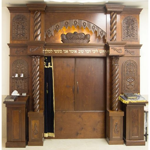 Custom designed and carved detail of wood torah ark for synagogue with lighting