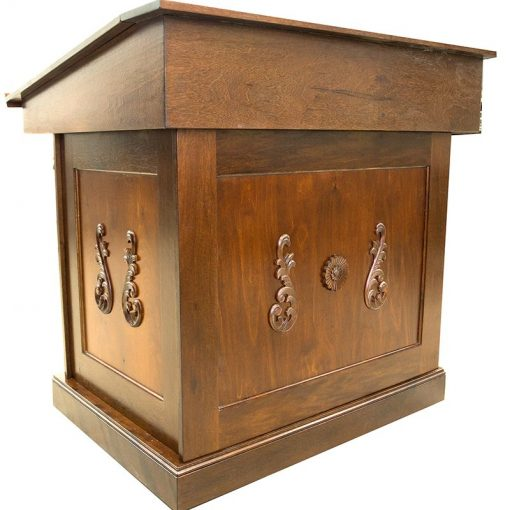 wood bimah with carving and angled table