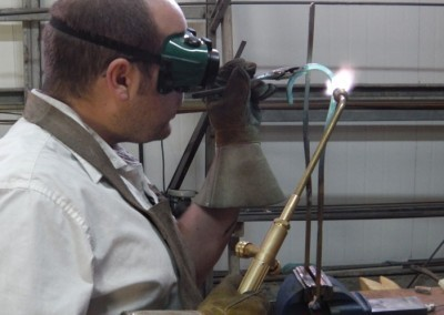 James welding a ner tamid crown