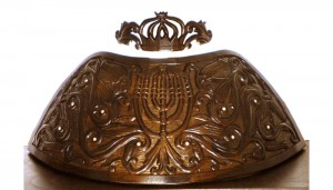 dome top of crown with deep relief carving