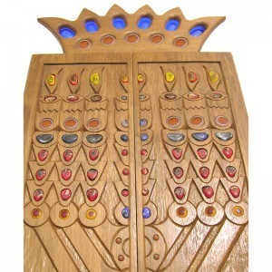 menorah aron kodesh with glass inlaid into the carved doors