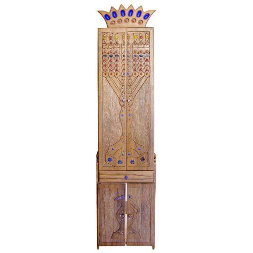 aron kodesh with carving and glass representing a menorah