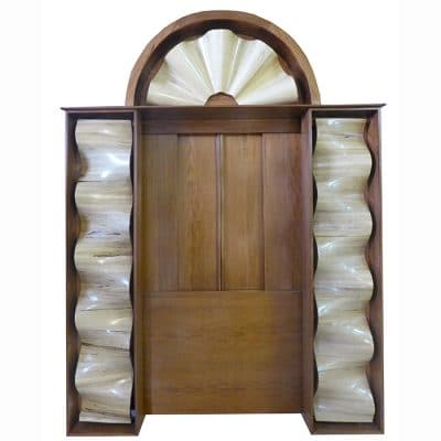 front view of torah ark with carved wood waves