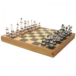 glass chess pieces and hardwood chess board