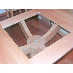 glass table top on cherry wood pedestal table
