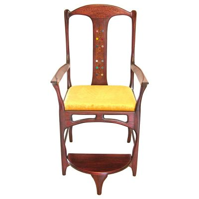Elijah's chair in contemporary design built from solid wood and carved