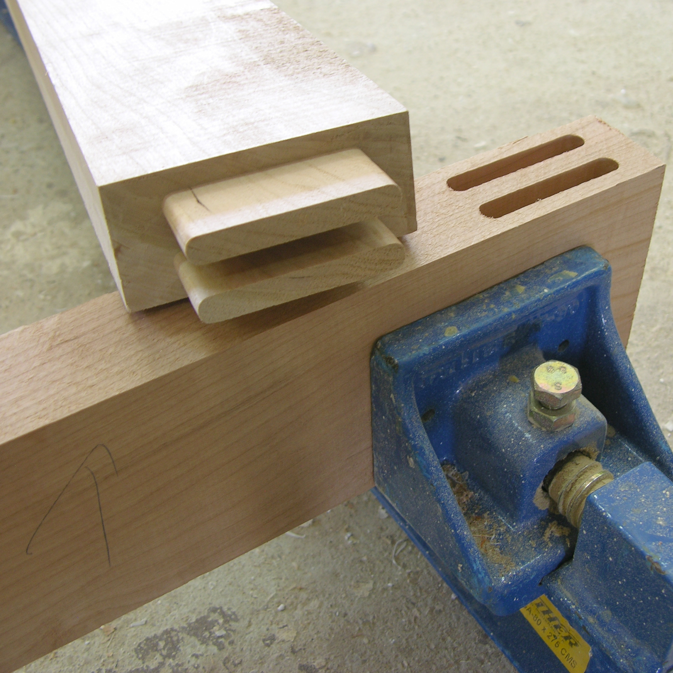 Quality: A vice holds a piece of wood to receive another joined piece
