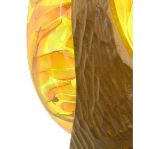 wood and glass mold blown detail of eternal light