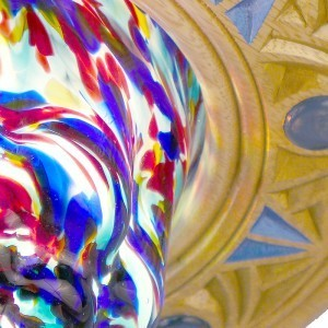 detail of mold blown glass and carving on eternal light