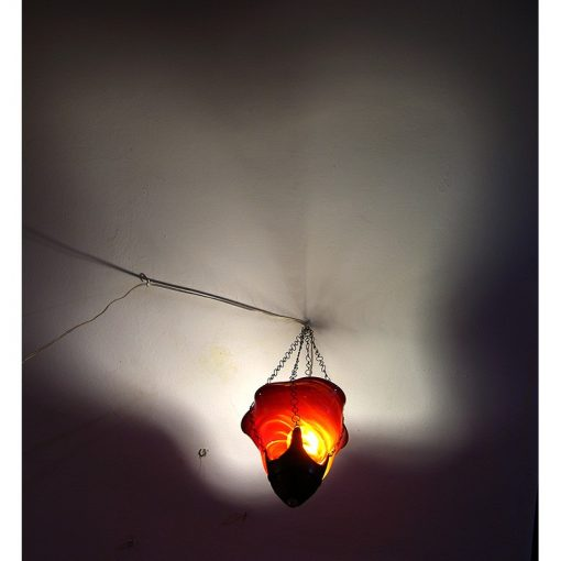 Red Horizon blown glass ner tamid reflection of shadow on ceiling