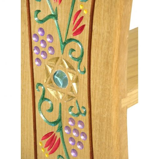 carved and painted floral stender inlaid and carved