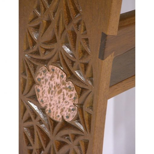 Carving and copper plate joinery detail of wood shtender