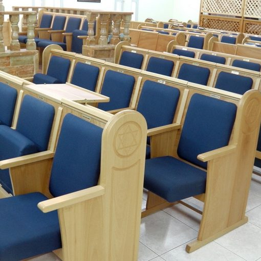 upholstered and carved sephardic synagogue seating with upholstery