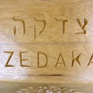 Tzedakah box custom designed for the Brooklyn Jewish Children's museum features hand carving