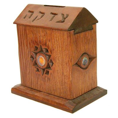 Sliding top tzedkaah box with hand carving and glass inlays