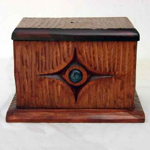 hand carved tzedakah box with texture and glass inlay
