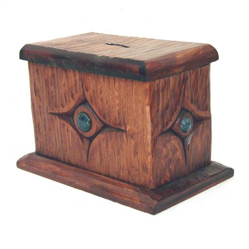hand carved tzedakah box with texture and glass inlay side view