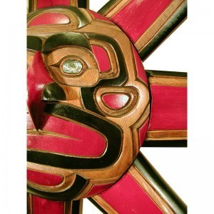 detail of sun mask wood carving northwest coastal style